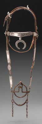 A NAVAJO SILVER AND TURQUOISE HEADSTALL c. 1900