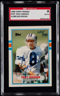 Football Cards:Singles (1970-Now), Signed 1989 Topps Traded Troy Aikman #70T SGC Authentic....