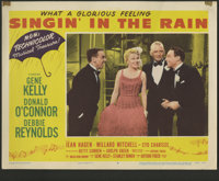 "Singin' in the Rain (MGM, 1952). Lobby Card (11"" X 14""). The high point in the careers of everyone involved wi..."