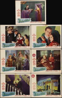 "The Uninvited (Paramount, 1944). Lobby Cards (7) (11"" X 14""). An excellent romance/ghost story starring Ray Mi..."