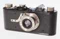 Photographs, Leica I Camera. German, 1930, No. 5067, for exposures 24 x 36mm on 35mm film, with Leitz Elmar 50 mm f/3.5 lens in Leitz lea...