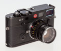 Photographs, Leica M7 Black Chrome Rangefinder Camera. German, 2001, No. 2781977, for exposures 24 x 36mm on 35mm film, with Leitz Summic...
