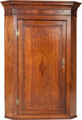Furniture : English, An English Oak and Mahogany Hanging Corner Cabinet, first quarter 19th century. 46-1/2 h x 33-1/2 w x 20-1/4 d inches (118.1...