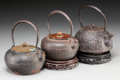 Asian:Japanese, A Group of Three Japanese Cast Iron Teapots. 9 inches high (22.9cm) (largest, handle raised). PROPERTY FROM THE ESTATE OF...(Total: 3 Items)