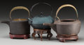 Asian:Japanese, A Group of Three Japanese Cast Iron Teapots with Stands. 7 incheshigh (17.8 cm) (largest, handle raised). PROPERTY FROM T... (Total:3 Items)