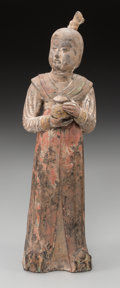 Asian:Chinese, A Chinese Tang Dynasty Polychrome Pottery Figure of an Attendant.12-3/8 inches high (31.4 cm). ...