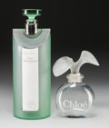 Art Glass:Other , Two Glass Factice Bottles: Bulgari au The Vert &Chloè by Chloè, late 20th century. 18 inches high ...(Total: 2 Items)