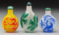 Asian:Chinese, A Group of Three Beijing Overlay Glass Snuff Bottles. 2-3/4 incheshigh (7.0 cm) (tallest). ... (Total: 3 Items)