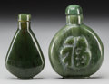 Asian:Chinese, Two Chinese Carved Spinach Jade Snuff Bottles. 2-3/4 inches high(7.0 cm) (taller). ... (Total: 2 Items)