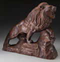 Decorative Arts, Continental:Other , A Continental Carved Oak Lion after Antoine-Louis Barye, late19th-early 20th century. 19-3/4 inches high x 22-3/4 inches lo...
