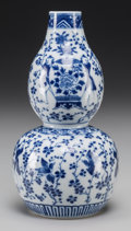Asian:Chinese, A Chinese Blue and White Porcelain Double Gourd Vase. Marks: Kangximark. 8-5/8 inches high (21.9 cm). ...