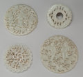 Asian:Chinese, A Group of Four Chinese Carved Jade Disks. 3-1/4 inches diameter(8.3 cm) (largest). ... (Total: 4 Items)
