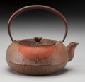 Asian:Japanese, A Japanese Iron Teapot, 20th century. Marks: (character marks underspout). 5-1/2 inches high x 6 inches wide (14.0 x 15.2 c...