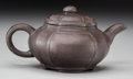 Asian:Chinese, A Chinese Yixing Teapot, 20th century. Marks: (character marks tounderside). 3 inches high x 5-3/4 inches wide (7.6 x 14.6 ...