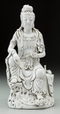 Asian:Chinese, A Chinese Blanc-de-Chine Seated Guanyin Figure. Marks: (twoimpressed character seals to reverse). 13 inches high (33.0 cm)...