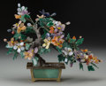 Asian:Chinese, A Chinese Carved Hardstone Blossom Tree, 20th century. 11-3/8inches high x 14-1/2 inches wide (28.9 x 36.8 cm). ...