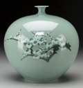Asian:Other, A Korean Celadon Porcelain Jar with Cherry Blossom Motif. Marks:(character marks to underside). 9-3/8 inches high (23.8 cm)...