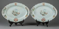 Asian:Chinese, A Pair of Chinese Export Porcelain Ovular Chargers with Armorial Crests, late 18th century. 14-1/2 l x 9 d inches (36.8 x 22... (Total: 2 Items)