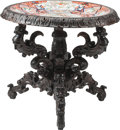 Furniture : Continental, A Renaissance Revival Carved Oak Center Table with Inset Imari Porcelain Charger, 20th century. 30 h x 34 d inches (76.2 x 8...
