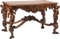 Furniture : Continental, A Venetian Carved Walnut Figural Center Table, 19th century. 32 h x54 w x 31 d inches (81.3 x 137.2 x 78.7 cm). ...