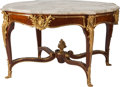 Furniture : French, A Large Louis XV-Style Gilt Bronze Mounted Kingwood Center Tablewith Marble Top, late 19th century. 32-1/4 h x 54 d inches ...(Total: 2 Items)