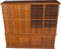 Furniture : American, A Large American Sixty-Four Drawer Oak Spool Cabinet, late 19thcentury. 62 h x 67-1/4 w x 19-3/4 d inches (157.5 x 170.8 x ...