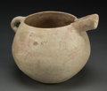 Judaica:Archaeology, CANAANITE. Early Bronze Age, circa 3000-2300 BCE. Terracottaspouted vessel. ...