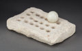 Judaica:History and Culture, ANCIENT NEAR EAST. Circa 500 BCE - 500 CE. Stone game board andtoken.... (Total: 2 Items)