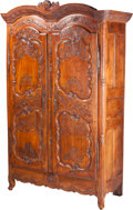Furniture , A Signed French Brittany Region Carved Cherrywood Armoire, circa 1803. Marks: Fait Par Pierre Riault L(') an XI de la Repu...