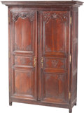 Furniture : French, A French Carved Walnut Armoire, 19th century. 86-1/4 h x 62-1/2 w x25 d inches (219.1 x 158.8 x 63.5 cm). PROPERTY FROM A...