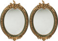 Decorative Arts, French:Other , A Pair of Louis XVI-Style Painted and Parcel Gilt Oval Mirrors,20th century. 45 h x 32 w inches (114.3 x 81.3 cm). ... (Total: 2Items)