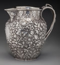 Silver Holloware, American:Pitchers, An S. Kirk & Son Silver Floral Repoussé Pitcher, Baltimore,Maryland, circa 1890. Marks: S. Kirk & Son, 11OZ. 8-3/4inch...