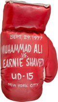 Boxing Collectibles:Memorabilia, 1977 Muhammad Ali vs. Earnie Shavers Oil on Boxing Glove by Steve Kaufman....