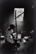 Photographs:Gelatin Silver, Unknown Artist (20th Century). Girl Grinding the Grain, 2000. Gelatin silver. 17-3/4 x 12 inches (45 x 30.5 cm). Signed ...