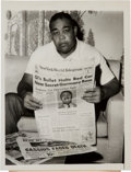 Boxing Collectibles:Memorabilia, 1964 Associated Press News Original Photograph of Joe Louis Holding Newspaper with Cassius Clay (Muhammad Ali) on the Front Pa...