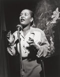 Photographs, Herman Leonard (American, 1923-2010). Billie Holiday, New York City, 1949. Gelatin silver, printed later. 12 x 9-3/8 inc...
