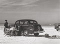 Photographs:Gelatin Silver, Marion Post Wolcott (American, 1910-1990). Winter visitors picnic on running board of car on beach, Sarasota, Florida, 1...