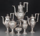 A Six-Piece S. Kirk & Son Coin Silver Tea and Coffee Service with Landscape and Ram Motifs, Baltimore, Maryland...