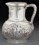A John Chandler & Edward Moore for Tiffany & Co. Silver Wine Pitcher with Bacchanal Motif, New York, New...