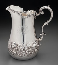 A Shreve & Co. Silver Water Pitcher with Floral Repoussé Motif, San Francisco, California, 20th century Marks...