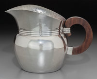 A William Spratling Ranch Pattern Mexican Silver Pitcher with Rosewood Handle, Taxco
