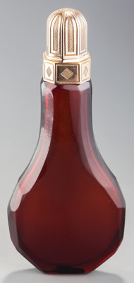 A French 18K Gold Mounted Amber Glass Scent Bottle, 18th century Marks: (hand), (miss struck mark) 4-3/8 inches