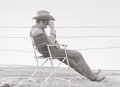 Photographs:Gelatin Silver, Frank Worth (American, 1923-2000). James Dean, on the set ofGiant (two photographs), 1955. Gelatin silver, printed late...(Total: 2 Items)