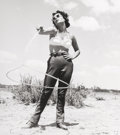 Photographs, Frank Worth (American, 1923-2000). Elizabeth Taylor with a lasso, on the set of Giant, 1955. Gelatin silver, printed lat...