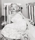 Photographs, Frank Worth (American, 1923-2000). Marilyn in a deckchair, 1954. Gelatin silver, printed later. 16-3/4 x 14-7/8 inches (...
