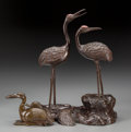 Asian:Japanese, Two Patinated and Polychrome Bronze Figural Groups: Storks andMinogame, early 20th century. 14 inches high (35.... (Total: 2Items)