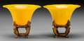 Asian:Chinese, A Pair of Yellow Beijing Glass Bowls with Stands, 20th century.Marks: CHINA. 2-1/2 inches high x 5-1/8 inches diameter ...(Total: 4 Items)