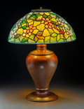 Art Glass:Tiffany , Tiffany Studios Leaded Glass and Bronze Apple Blossom TableLamp. On Pine Needle Oil Lamp base. Circa 1910. ...