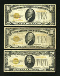 Small Size:Gold Certificates, Fr. 2400 $10 1928 Gold Certificate. Two Examples. VG; Fine. Fr. 2402 $20 1928 Gold Certificate. Fine.. ... (Total: 3 notes)