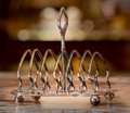 Silver Holloware, British, An English Silver-Plated Toast Rack, late 19th century. 7 incheswide (17.8 cm). ...